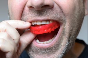 man wearing a red mouthguard